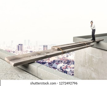 businessman looking improvide bridge and he is thinking what to do