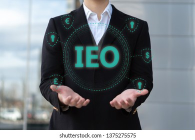 Businessman looking at Initial Exchange Offering IEO graphic a fundraising event