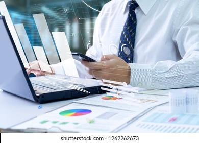 Businessman looking into a laptop computer notebook deeply reviewing a financial report for a return on investment or investment risk analysis.
