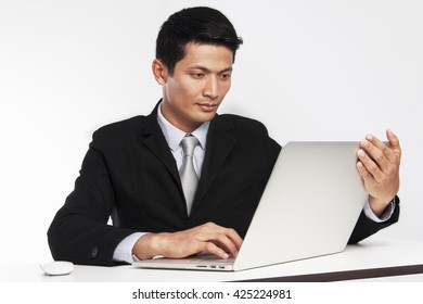 Businessman looking laptop for a business  market worldwide on white background.