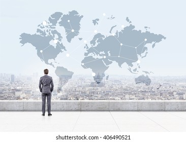 Businessman looking at map with networking system on cityscape background