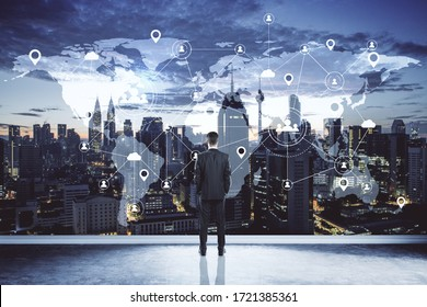 Businessman looking on creative glowing cloud email map hologram on dark backdrop. Cloud computing, newsletter and interactive hud concept.