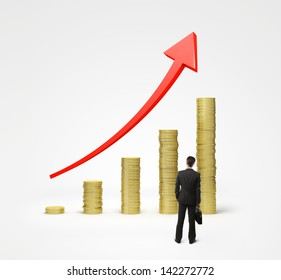 businessman looking on gold coins chart