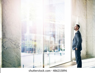 Businessman looking outside the window