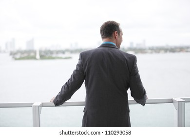 Businessman looking over the horizon