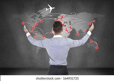 businessman looking at scheme of international flights