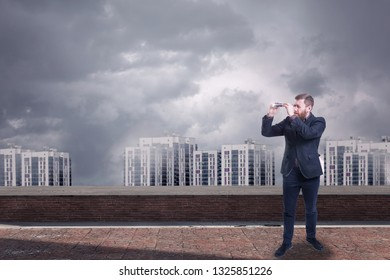 A businessman looking with spyglass for best deal