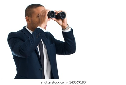 Businessman Looking Through Binocular Over White Background