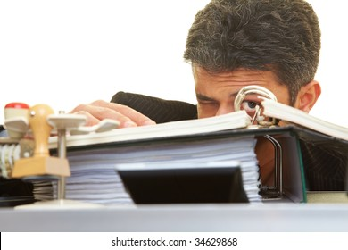 Businessman looking through files