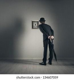 Businessman looking through keyhole