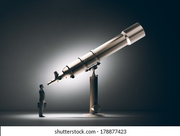 A businessman looking through a telescope