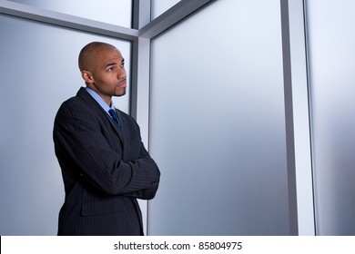Businessman looking through the window with a worried expression.