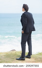 Businessman looking the view at the beach
