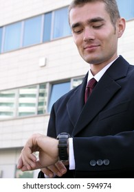 Businessman looking at watch