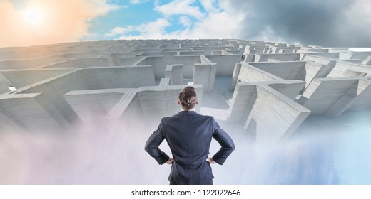 businessman looking for a way out of the maze concept
