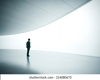 Businessman looking at wide shining screen