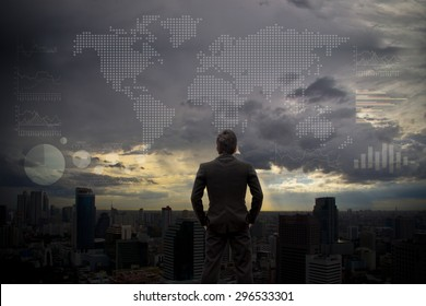 Businessman looking the World map on sky