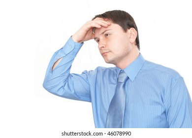 Businessman looks up in despair, scratching his head