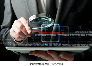 Businessman looks for the malicious code of a virus