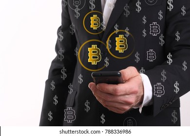 The businessman looks at the smart phone crypto curency bitcoin pay.