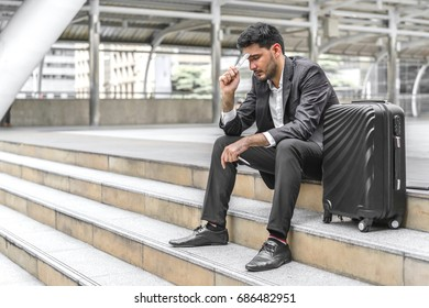 Businessman are lose to earn a profit from doing business. Male holding dollar currency. Concept of financial and salary.