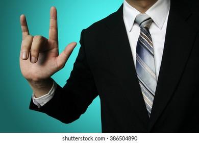 businessman love hand ,Businessman pressing an imaginary button on bokeh over dark background
