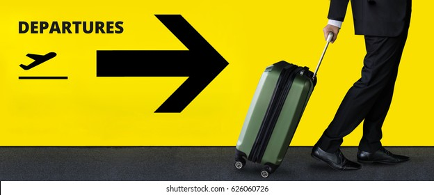 Businessman with luggage in Airport terminal, Business trip concept, Airplane Departures Sign as background