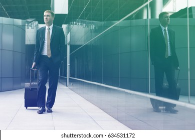 Businessman with luggage on the way to traveling