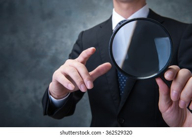 Businessman, magnifying glass
