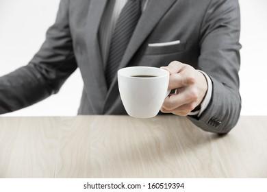 Businessman makes coffee break. Close up