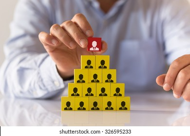 Businessman Making a Business Team Pyramid with Colorful Wooden Cubes