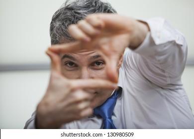 Businessman making a finger frame