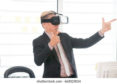 Businessman making gestures when wearing virtual reality goggles