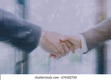 Businessman making handshake with a businesswoman on futuristic technology connection shape motion blur background