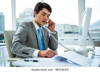 Businessman making a phone call in an office