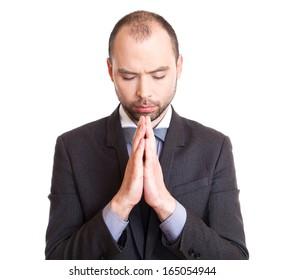 Businessman making a prayer.