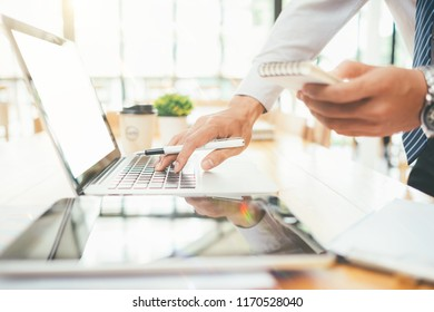 Businessman making presentation with his colleagues and business tablet digital computer at the office as concept warm colours sun light