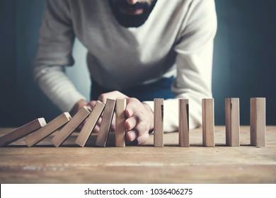 businessman making a pyramid  wooden cubes