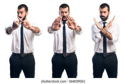 Businessman making stop sign