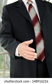 Businessman male hand reached to seal the agreement on business background