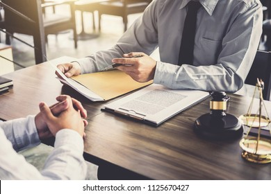 Businessman and Male lawyer or judge consult having team meeting with client, Law and Legal services concept.