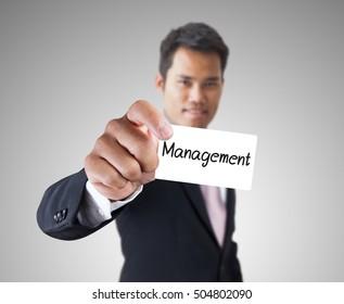 Businessman with management text label.