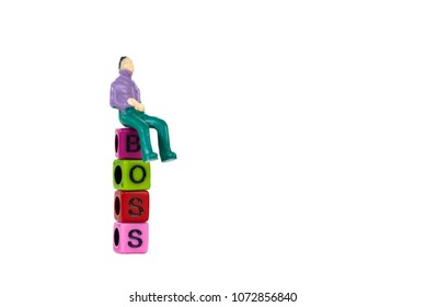 Businessman or manager or boss sitting on BOSS text made from colorful beads or letter bead on white background, finance and business concept idea.