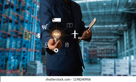 Businessman manager Holding Light bulb of icon of logistics , Creativity and innovative or idea for workers with Modern Trade warehouse logistics.