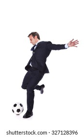 Businessman manager kicking a soccer ball