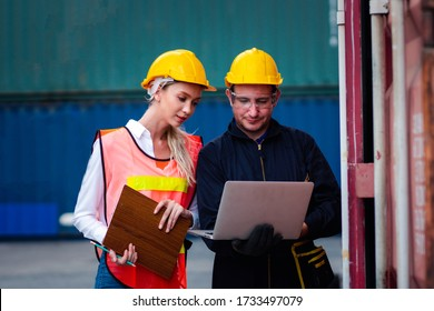Businessman manager using laptop check and discussing orders colleagues and control container transportation and export with commercial docks with shipping yard logistics. Industry of logistics.