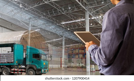 Businessman manager using tablet check and control for workers with warehouse and cargo transport or global business commerce concept or import-export commercial logistic Industry 4.0 concept