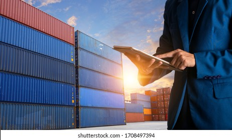 Businessman manager using tablet check and control for workers with Modern Trade warehouse logistics. Industry 5.0 Logistic and transport concept.