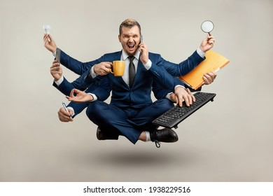 Businessman with many hands in a suit. Works simultaneously with several objects, a mug, a magnifying glass, papers, a contract, a telephone. Multitasking, efficient business worker concept - Shutterstock ID 1938229516