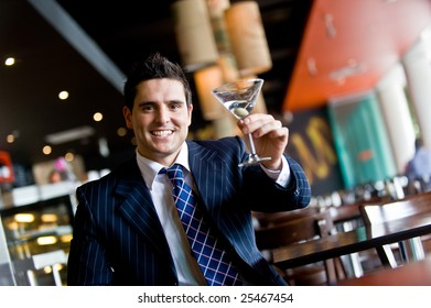 Businessman with martini in a bar